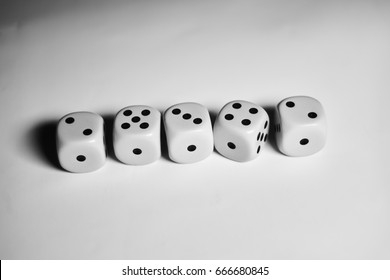 Five dices in a row on white background
