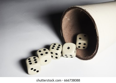 Five dices thrown out of a cup