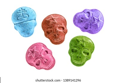 Five different colors of Army Skull, Ecstasy, MDMA or medication pills shaped like a skull isolated on a white background.
