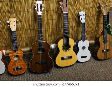 Five different ukuleles