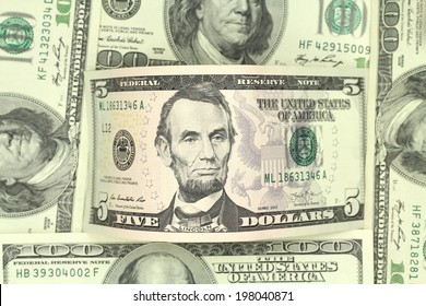 five dollars bill in abstract background
