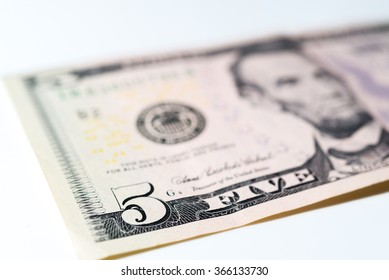 Five dollars bill. Close-up on 5 dollars bill on white background.
