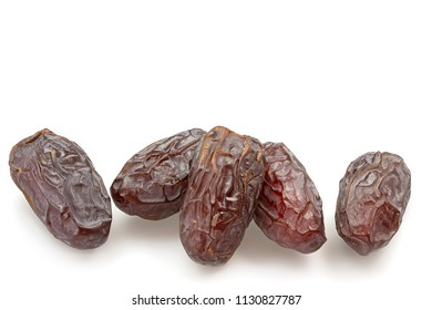 Five dried dates isolated on white