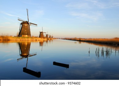 """Five  dutch windmills in """"Kinderdijk"""", a famous village in the Netherlands where you can visit the  old traditional windmills."""