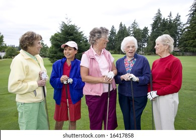 Five elderly women holding their golf clubs.  Horizontally framed photo.