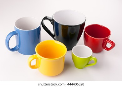 Five empty coffee cups, different sizes. In the order and color of the Olympic rings