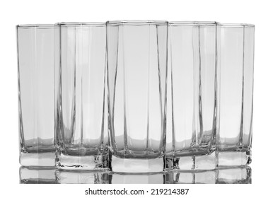 Five empty glasses isolated on white background