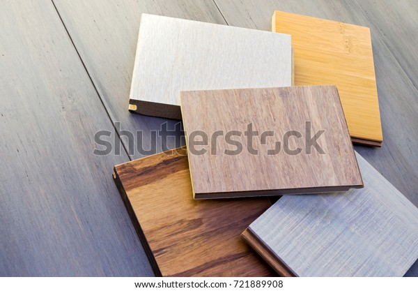 five flooring sample pieces tongue and groove design on top of wide plank bamboo floor