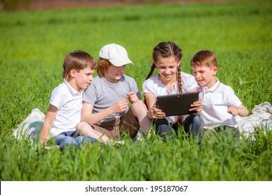 Five friends sitting on grass