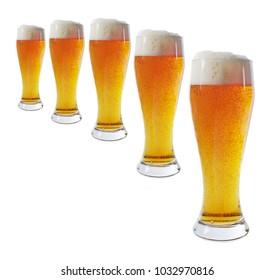 Five glasses of beer. Isolated on white