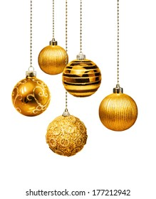 Five gold decoration Christmas balls hanging isolated