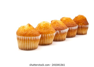 five golden muffins ready to eat