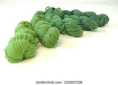 Five Gradient Green Skeins of Yarn