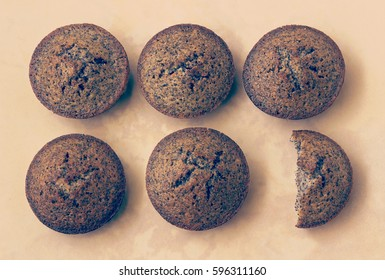 Five and a half muffins arranged on the table -filter effect retro vintage style