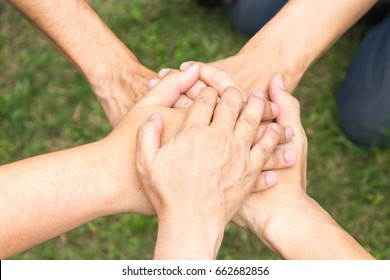 Five hands combined for teamwork