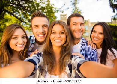 five happy best friends with toothy smile making selfie photo.