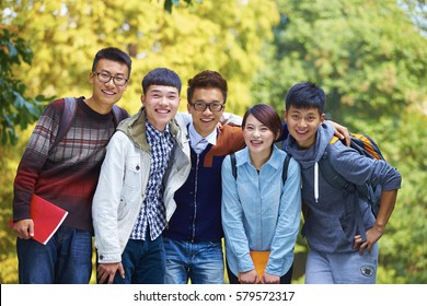Five Happy Chinese College Students Smile at Camera in Campus