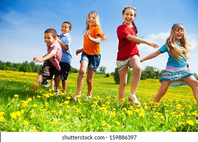 Five happy diversity looking children running in the park