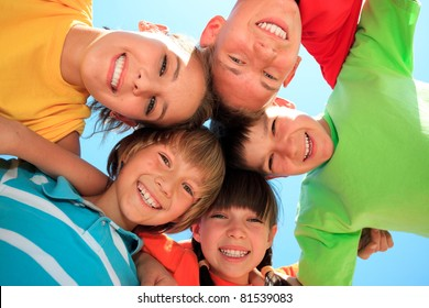 Five happy kids in circle