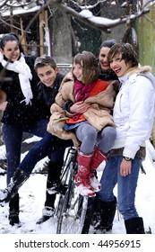 five happy people in winter season