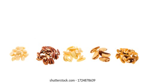 Five of the healhiest nuts including brazilian, pecans, pili, macadamia and walnuts on an isolated background.