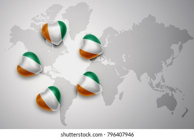 five hearts with national flag of cote divoire on a world map background..concept.3D illustration