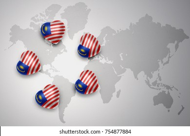 five hearts with national flag of malaysia on a world map background..concept.3D illustration