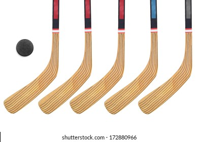Five hockey sticks on a white background. Isolated