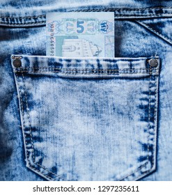 Five hryvnas in the blue jeans pocket. Gryvna, gryvnia, hrivnia, hrivnia, grivnia, grivna