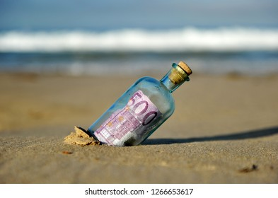 Five hundred (500) euro banknote inside a bottle found on a beach, concept of tax paradise, currency traffic
