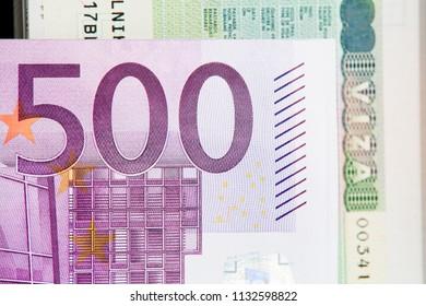 Five hundred euro banknote on euro visa background close-up