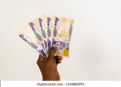 Five Hundred Naira notes spread out in hand isolated on white background for finance and banking concept
