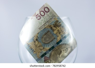 Five hundred Polish zlotys inside the wine glass