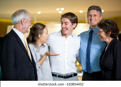 Five Joyful Business People Embracing and Laughing