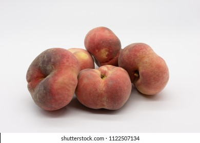 five juicy vineyard peaches, isolated on white background