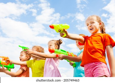 Five kids play with water guns