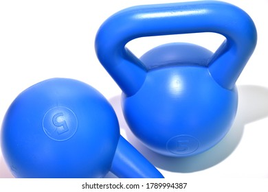 Five kilograme blue kettlebell with shadows isolated on white background