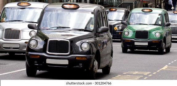 Five London Taxi Cabs in Canary Wharf (licence plate numbers removed)