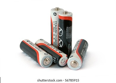 Five low-cost batteries on white background