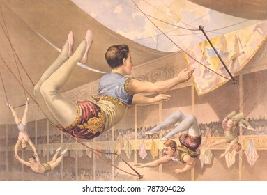 Five male trapeze artists performing high above the audience, in a large circus tent, 1890. The trapeze performance was developed by Jules Leotard, a French acrobat and aerialist, in Toulouse in the m