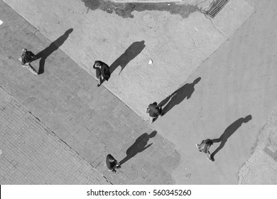 Five men in different directions, five long shadows