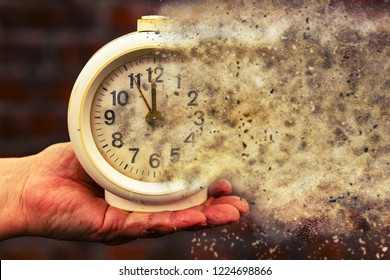 Five minutes to twelve. Time is running out concept shows clock that is dissolving away into little particles