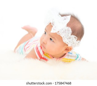 Five months baby girl with white  headband on white background