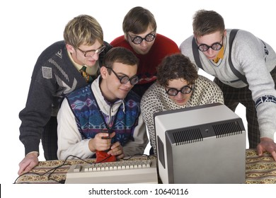 Five nerdy guys playing on old-fashioned computer. They are enjoying it. Front view, white background
