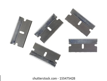 Five new razor blades arranged on a white background.