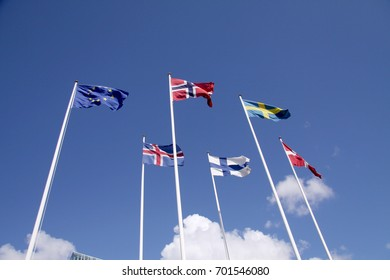 Five Nordic flags on flagpoles with EU flag. Denmark, Sweden, Norway, Finland, Iceland and European Union.