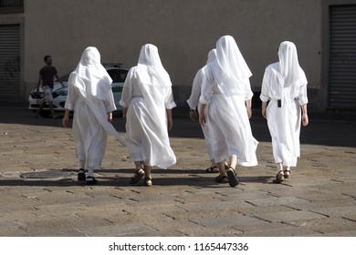 Five nuns walking in Duomo square, Milan, Italy