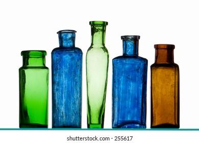Five old colored medicine bottles