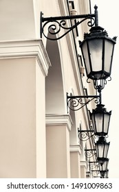 Five old-fashioned wrought iron lanterns.