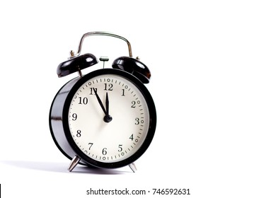 Five five on the clock on a white background